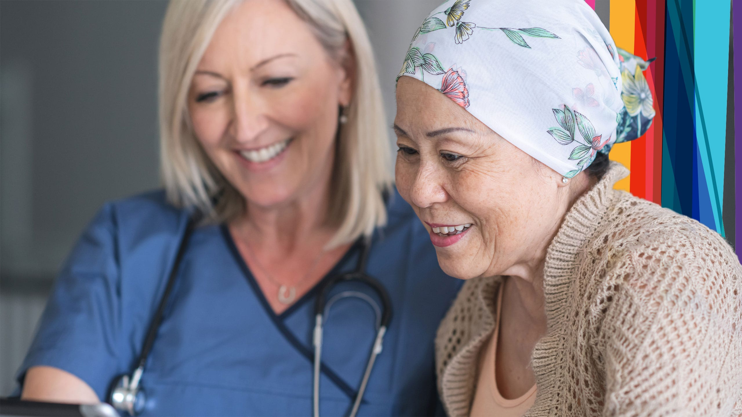 An oncology nurse interacting with a cancer patient